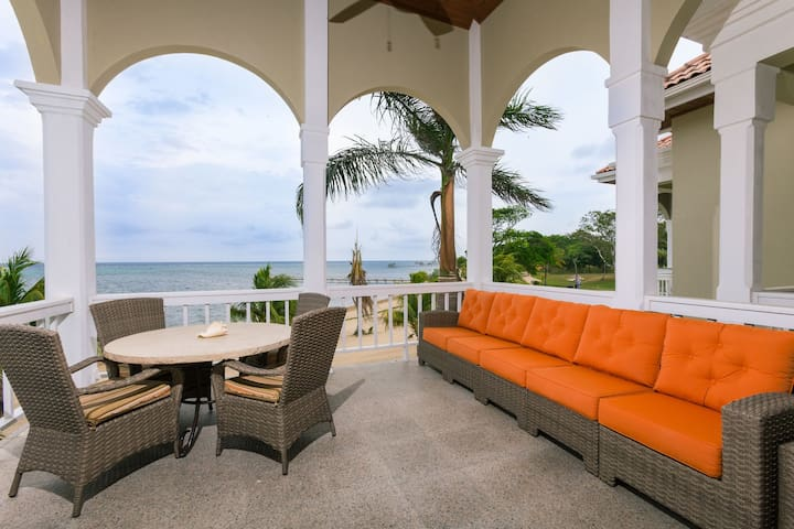 Outdoor dining and lounge area faces the ocean