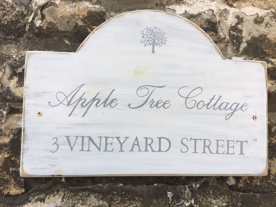 Our hand painted, bespoke sign for the cottage which is named after the gorgeous apple tree in the garden