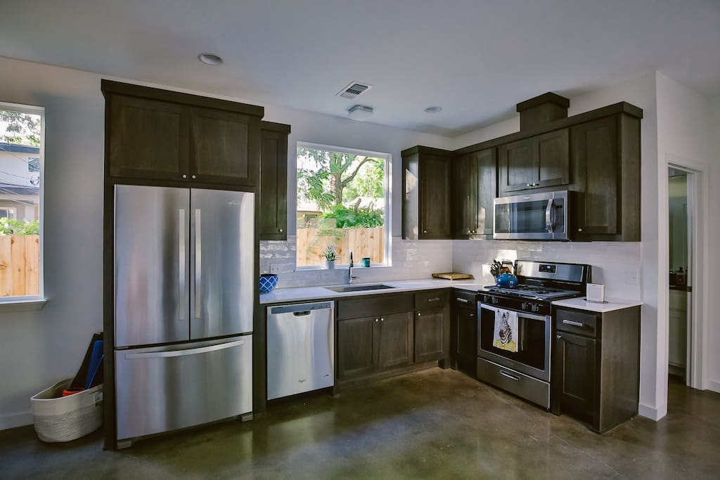 modern kitchen with gas stove and microwave