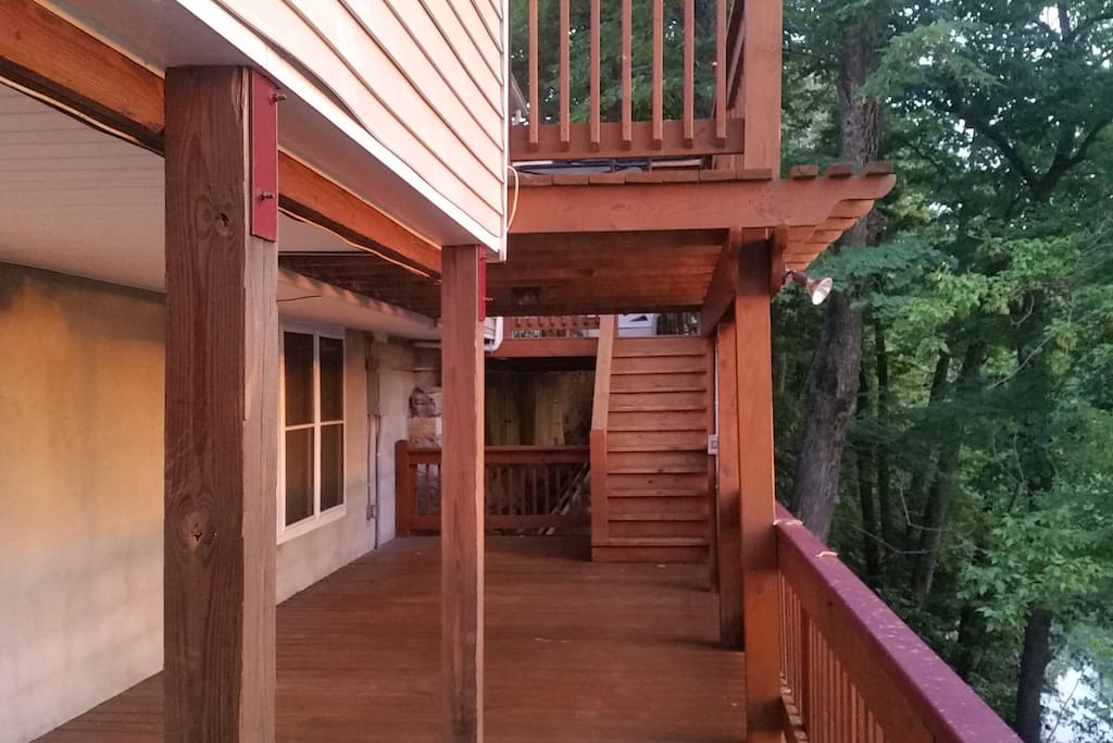 The deck from the lower level bedroom leading up to the parking area
