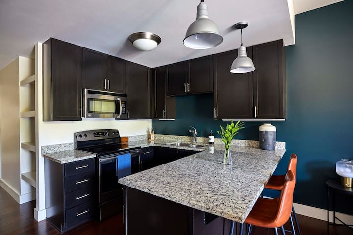 Fully-equipped modern kitchens with countertop bar.