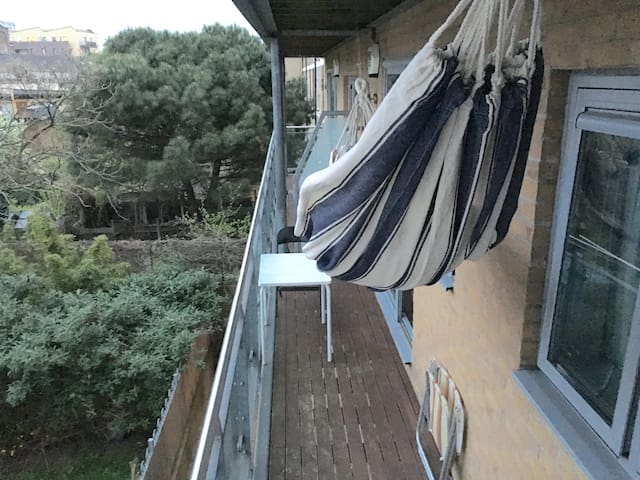 Relax on a quite, sheltered and sunny balcony in the hammock!