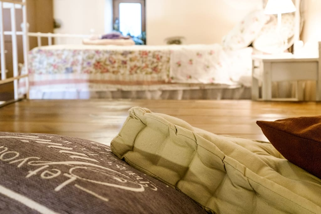 Open space on a wooden floor with cushions. A cozy little nest