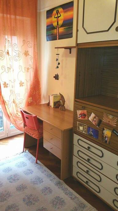 ...provided with a desk and a wide closet