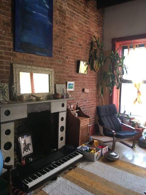 Living room now. Comfy, beautiful light. Playful. Original art.