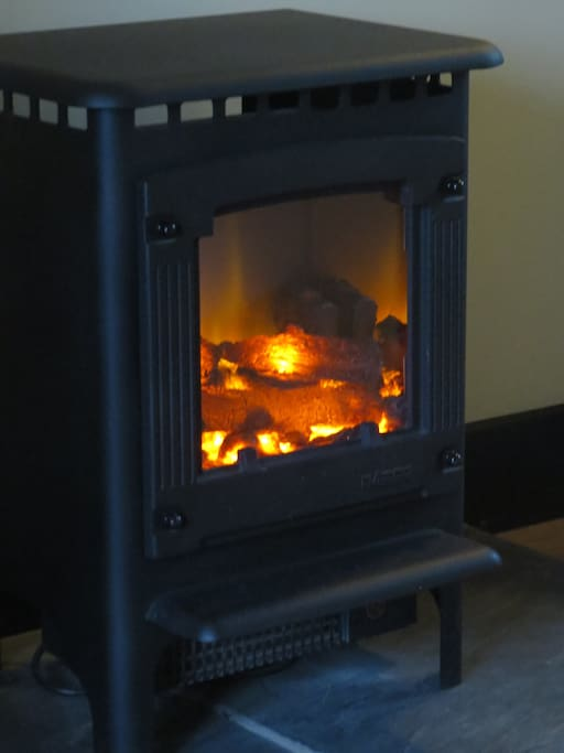 OK - it isn't real - but it is cosy, and you can turn it off if you're too hot!