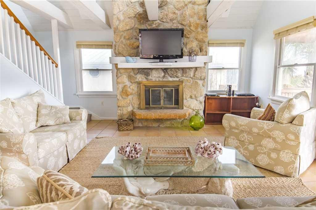 Gather in the lovely living room for movie night! - Pop a few bowls of popcorn, put a movie in, and settle into our generously st