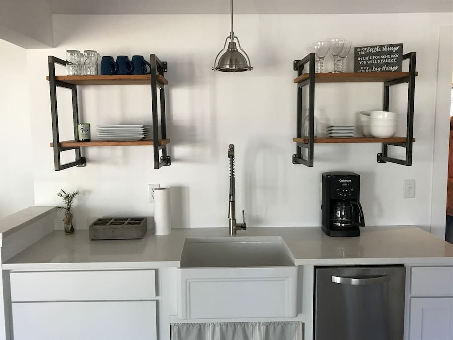 Farmhouse sink, custom shelving, brand new dishwasher, and all tools needed to cook/bake.