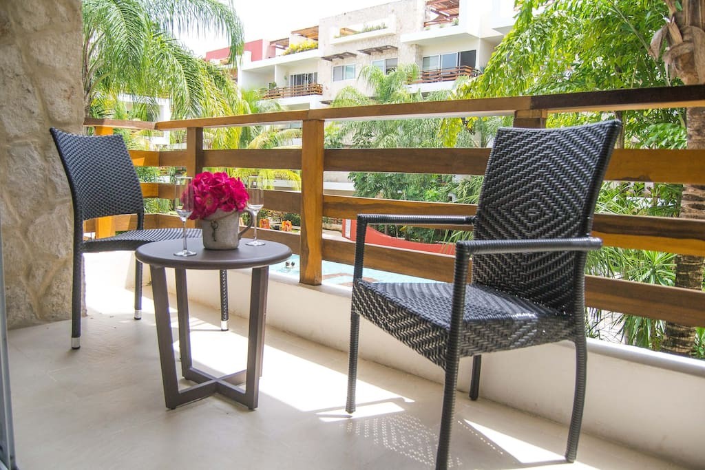 Balcony with chairs and table where you can have your coffee in the mornings!!