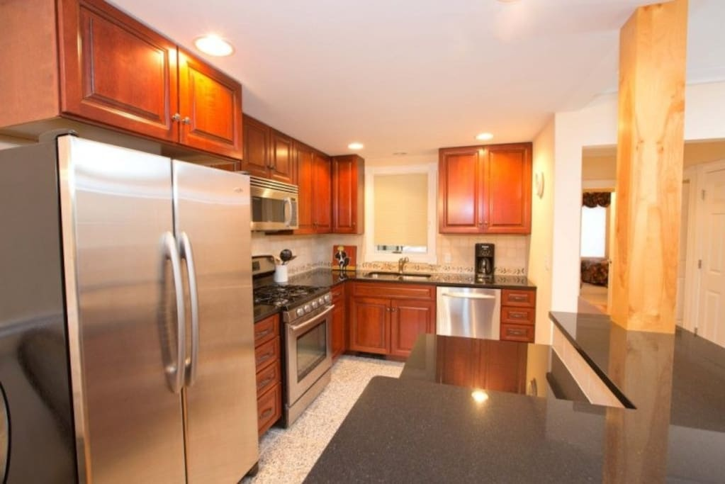 Stainless appliances and granite counters in kitchen
