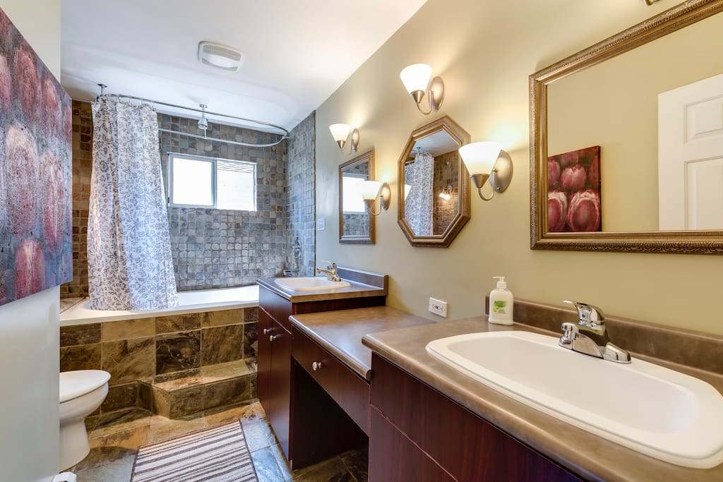 Second floor shared bathroom with soaker tub , rain shower, 2 sinks