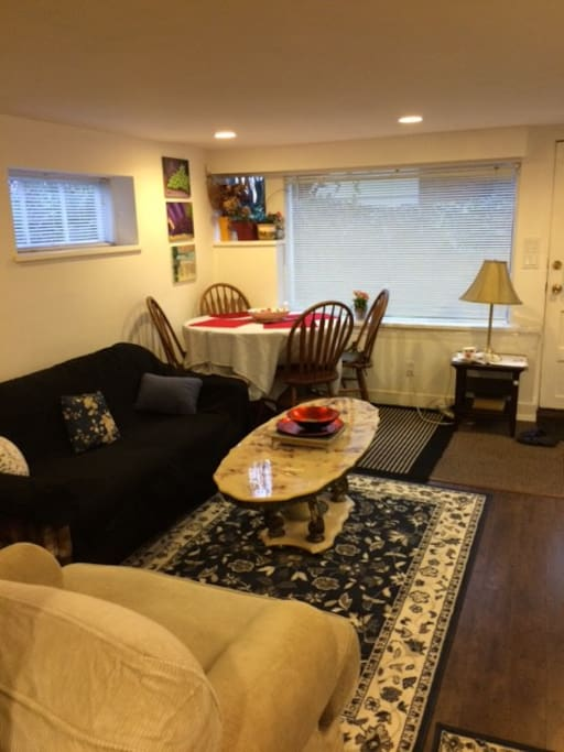 Second photo of living room and dining table for guests.