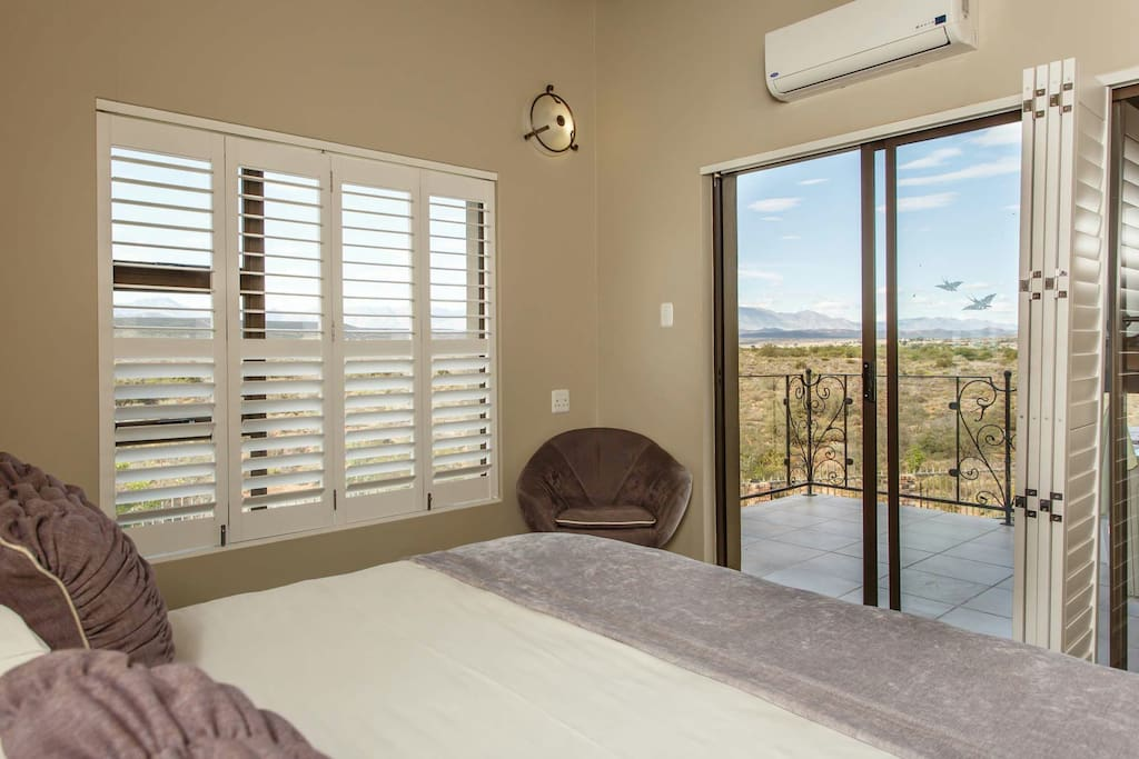 The room and the balcony. View over the veld and mountans. the