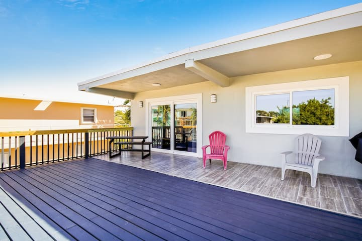 New listing! Newly-remodeled retreat w/open floor plan, canal views, and deck!
