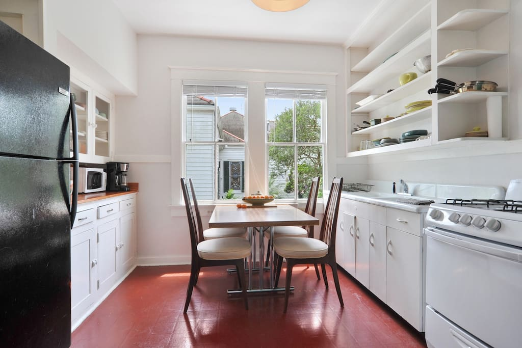 The kitchen has utensils and lots of dishes for your dining pleasure