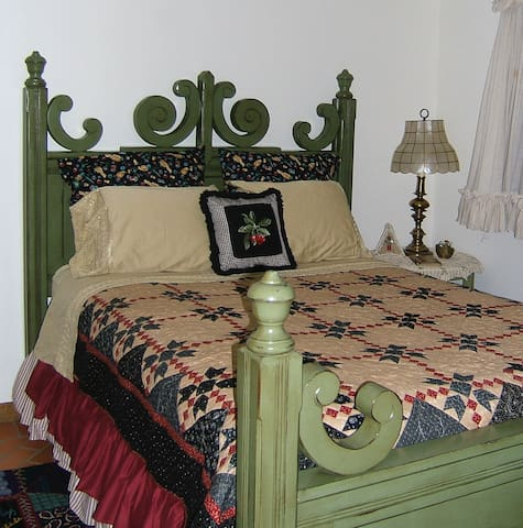 Queen Bed with hand made quilt.
