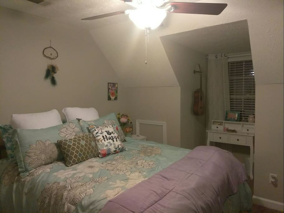 bedroom with queen bed, tv with DVD player and Netflix/Hulu, and dresser and closet space.