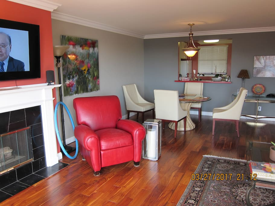 Large living room with  beautiful hardwood floors and comfortable reclining chair