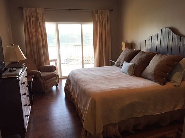 Maste bedroom with balcony access and great view. Does have blackout curtains.