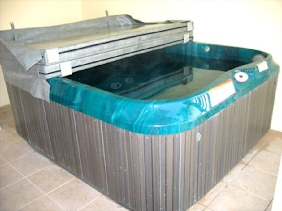 Huge private hot tub on our porch.
