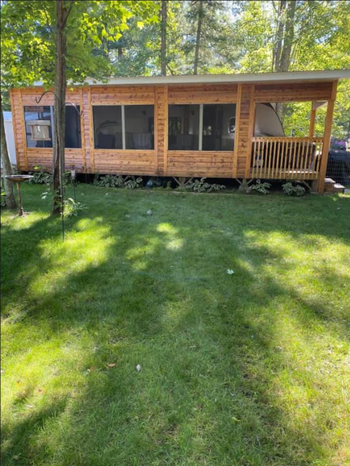 Travel trailer with  screened in porch and dog run