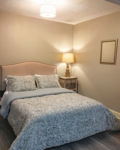 Guest Bedroom with queen-size bed.