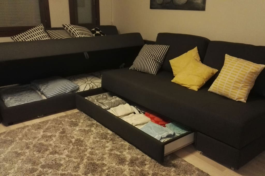 Pillows, blankets, bed linen and towels are inside the sofa.