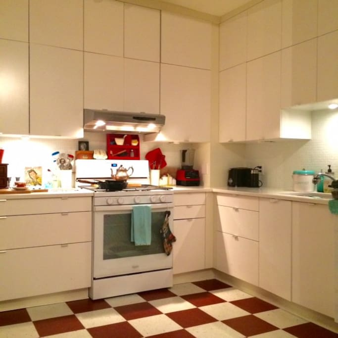 Bright open concept kitchen off the living room with character tiles floors