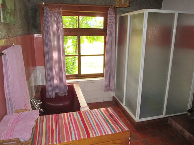 Bathroom, simple, but with good shower pressure . Solar hot water heating in the summer. In the winter, the water is heated with a woodburner