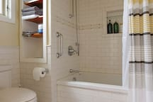 Soaker tub with shower. Separate door from the sink area.