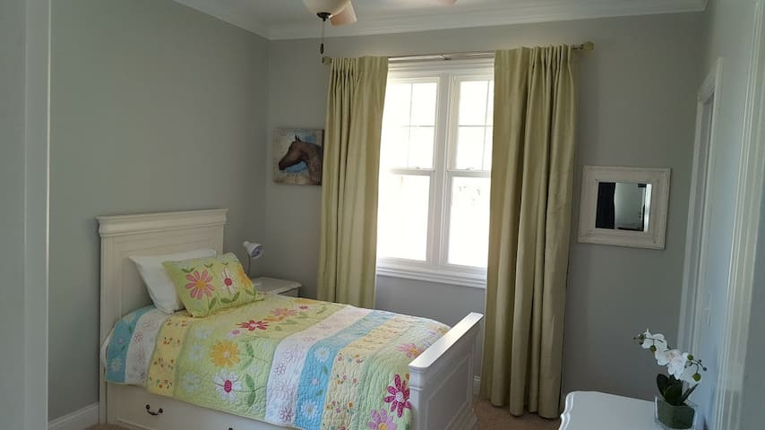The white room has amazing views and a single bed with a trundle bed. Also has a designated dresser and walk in private closet.