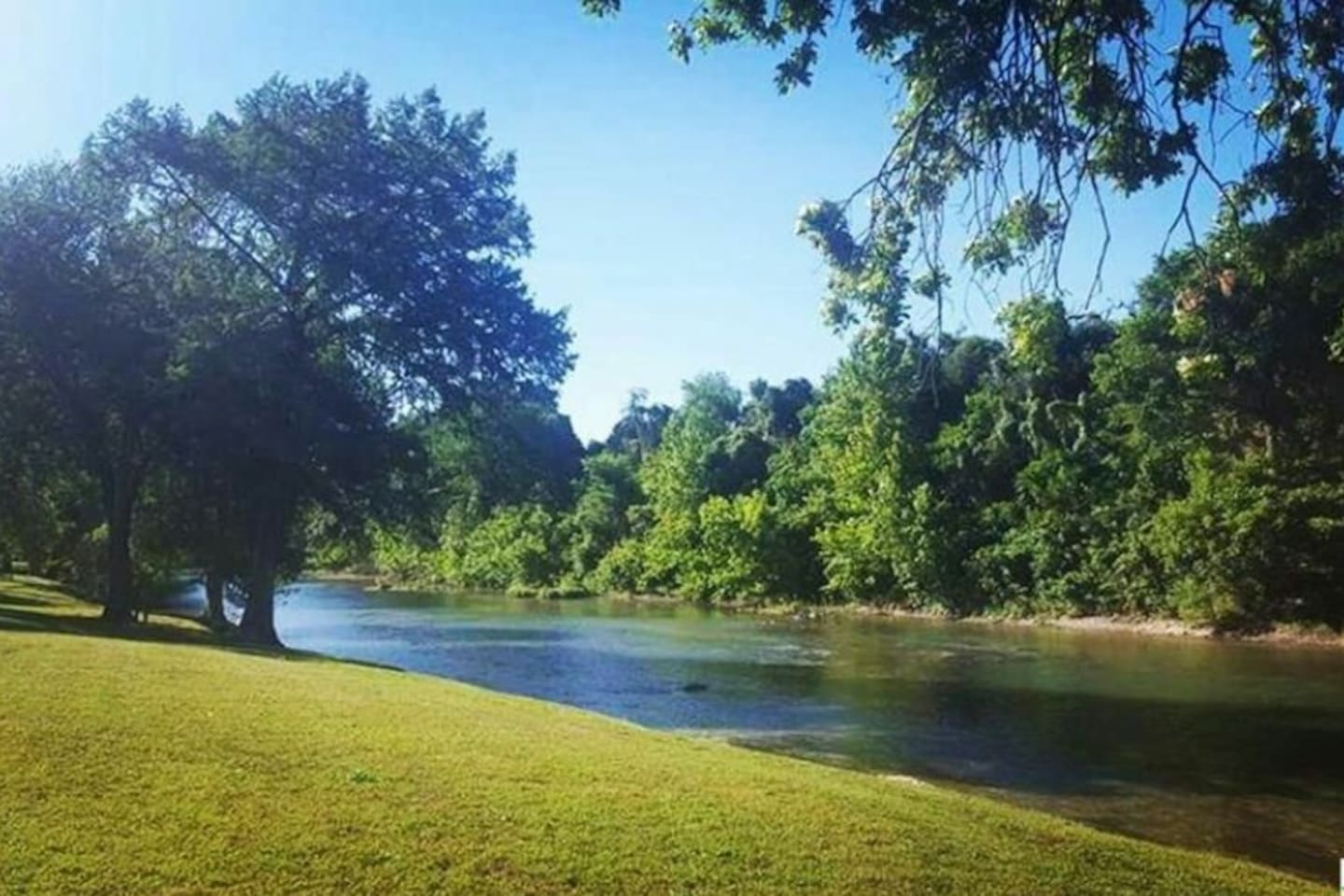The Guadalupe river 1/4 mile away in neighborhood park.  Popular exit for long floats from Gruene.
