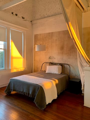 Sleeping nook with queen bed + privacy curtain
