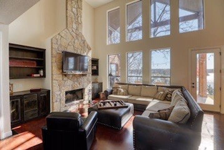 Huge and open concept great room overlooking the lake nice big couches to enjoy