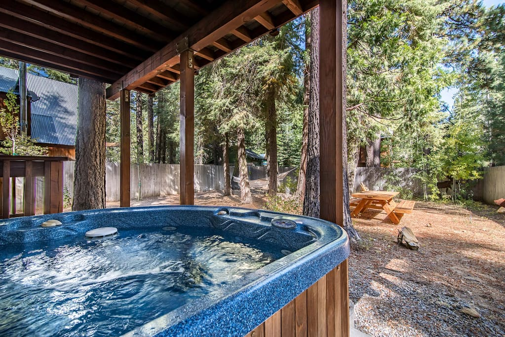 Relax in the backyard's stunning hot tub after a long day.