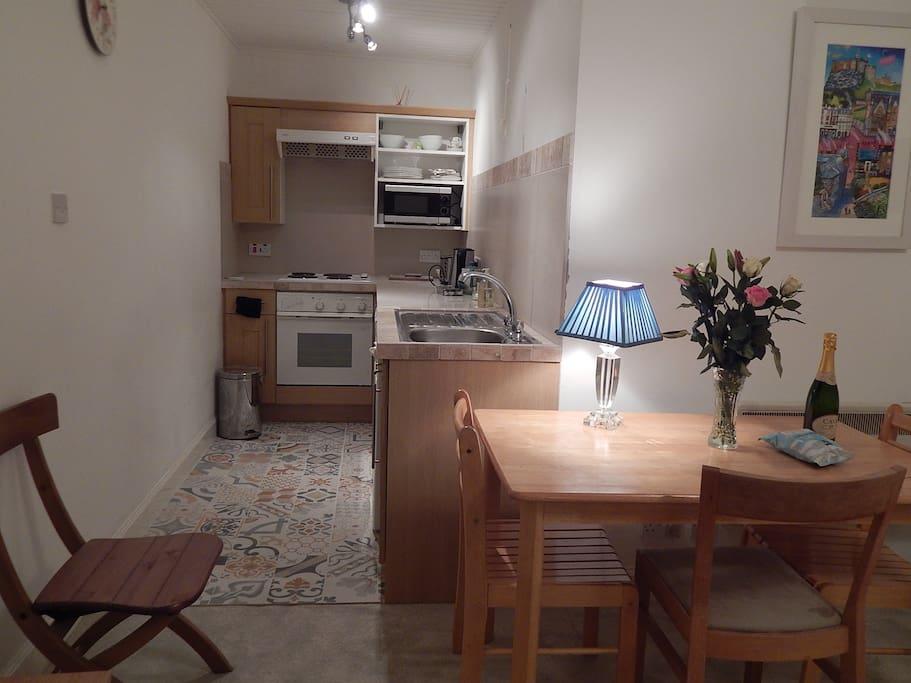 Kitchen adjacent to dining/sitting room