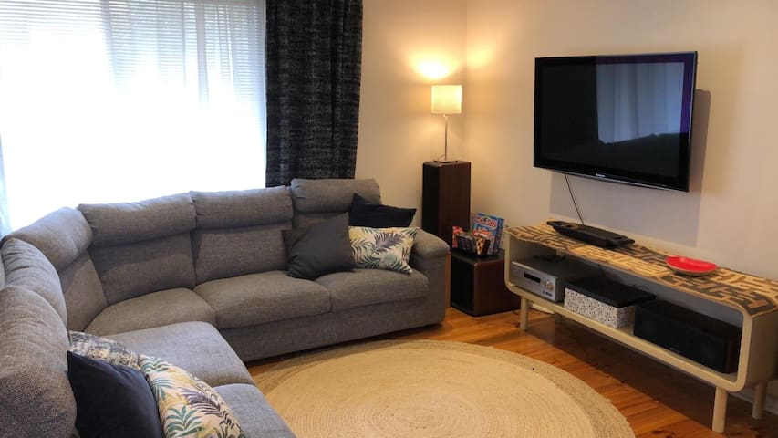 Lounge with queen sofa bed and air conditioning