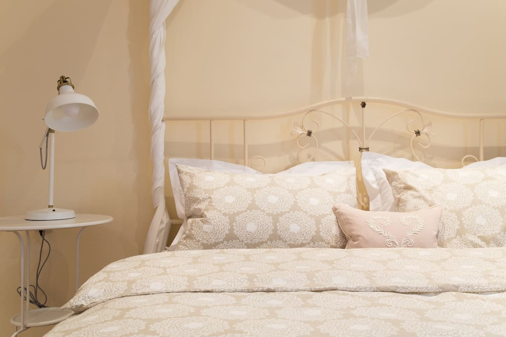 A pale palette and luxurious linen keep this bedroom soft and airy