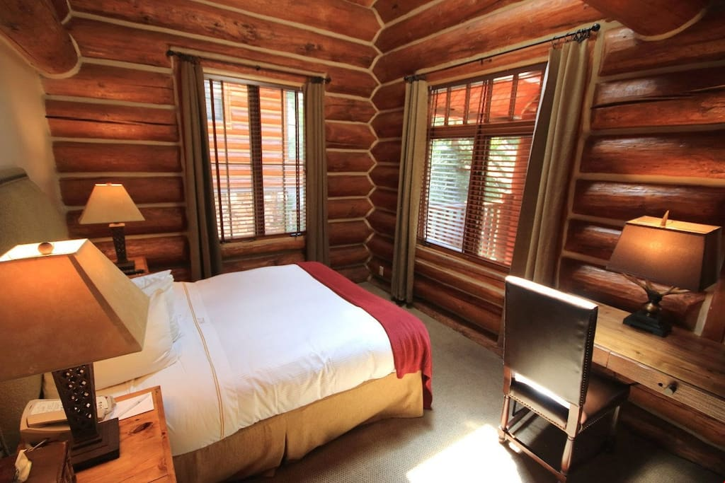Enjoy this cozy wooden style bedroom. Photos are rep