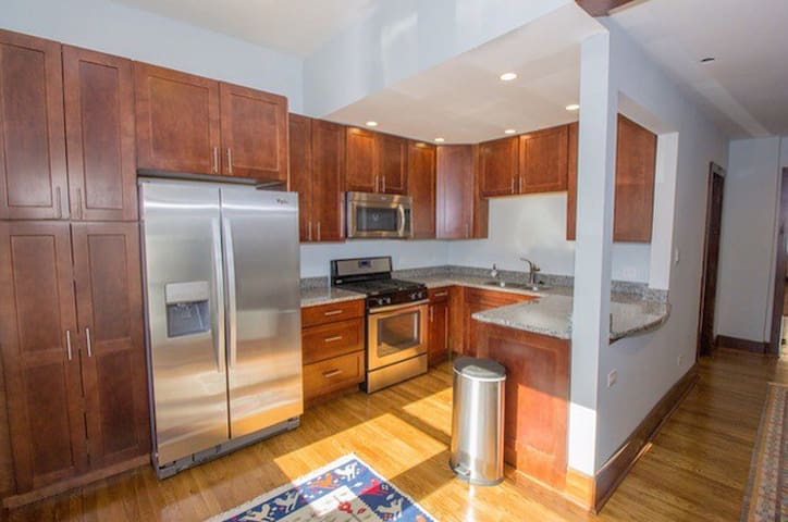 2 BR in hip Logan Square (cute baby and dog, too!)
