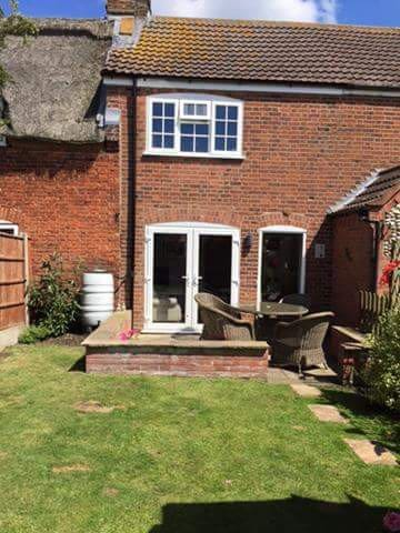 Private, fully enclosed garden - perfect for relaxing in the sun with a glass of something.  There is a shed offering additional storage for bikes.