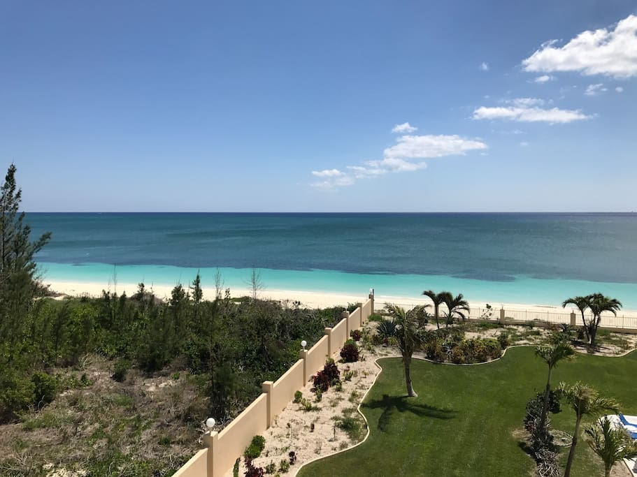 view of beach and pool from balcony