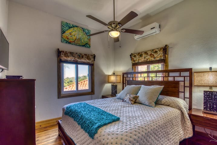 Master bedroom with king bed, TV, AC and private full bathroom