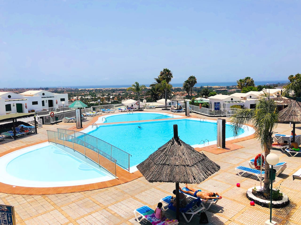 Swimming pool with great solarium and watching the dunes and the sea
