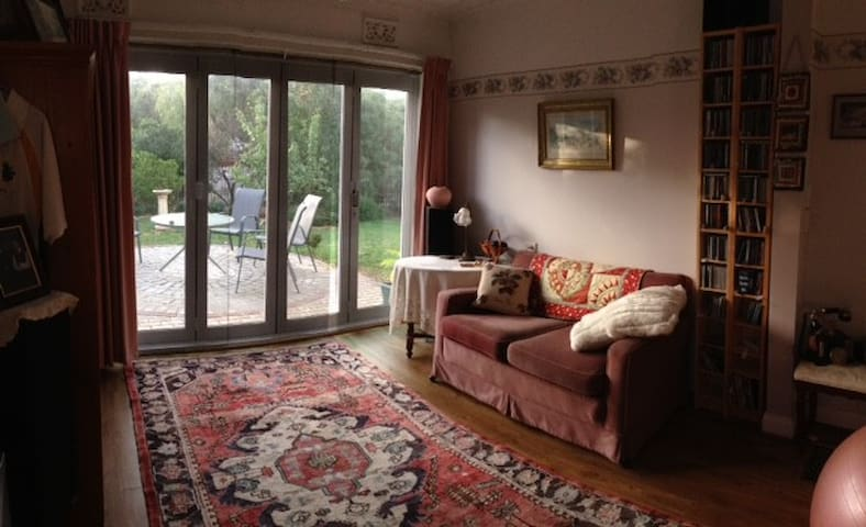 Sunny family room facing private front garden