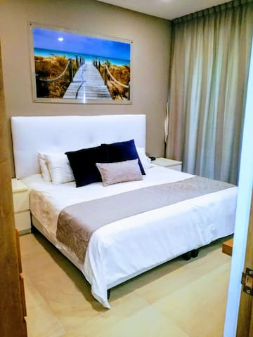 Closed bedroom with KS bed and hotel quality sheets and duvet
