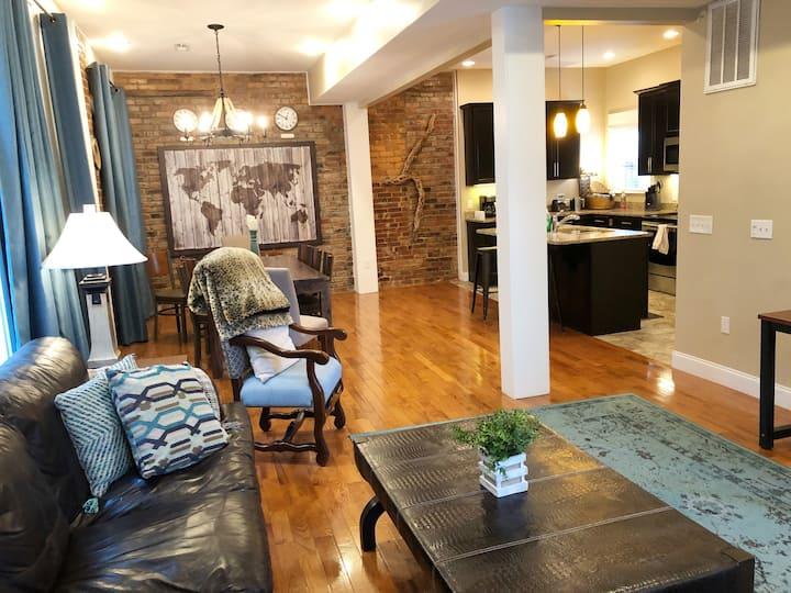 Luxury 3-story townhome w/ exposed brick & 2 decks