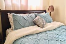 Cozy queen sized bed in the bedroom!