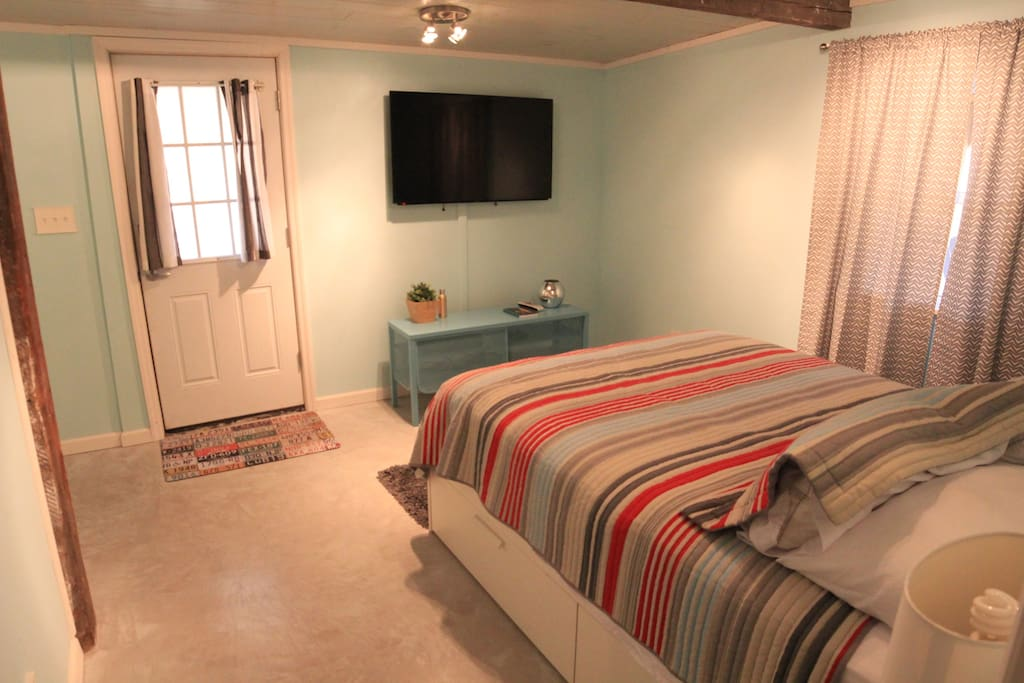 """50"""" TV and DirecTV services, including WiFi.  This view is from the entrance to the very spacious bathroom!"""