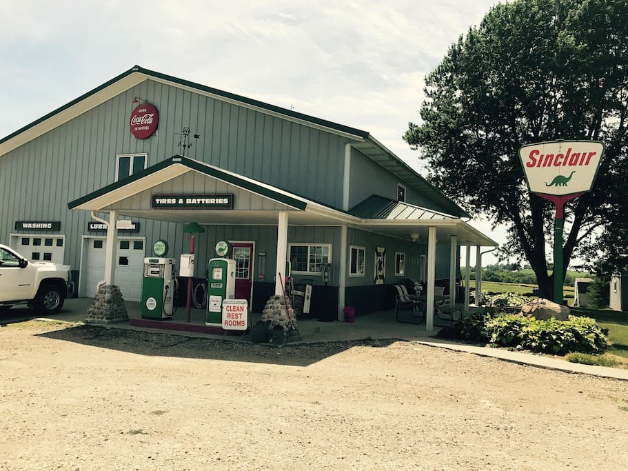 Antiques give the exterior the look of an old Sinclair gas station.